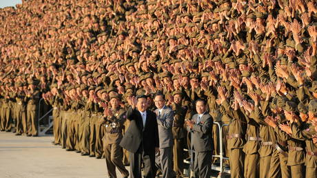FILE PHOTO: North Korean leader Kim Jong-un greets military members on the 73rd anniversary of the country's founding, Pyongyang, North Korea, September 9, 2021. © REUTERS/KCNA